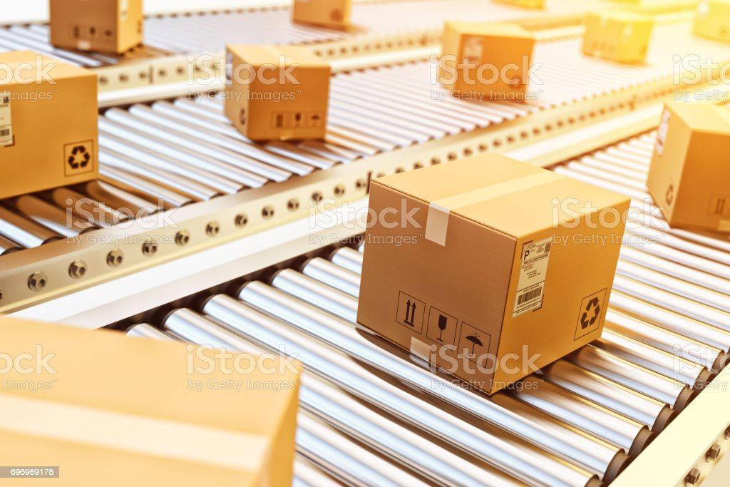 Packages delivery, packaging service and parcels transportation system concept Cardboard boxes on conveyor belt in warehouse Automated Stock Photo