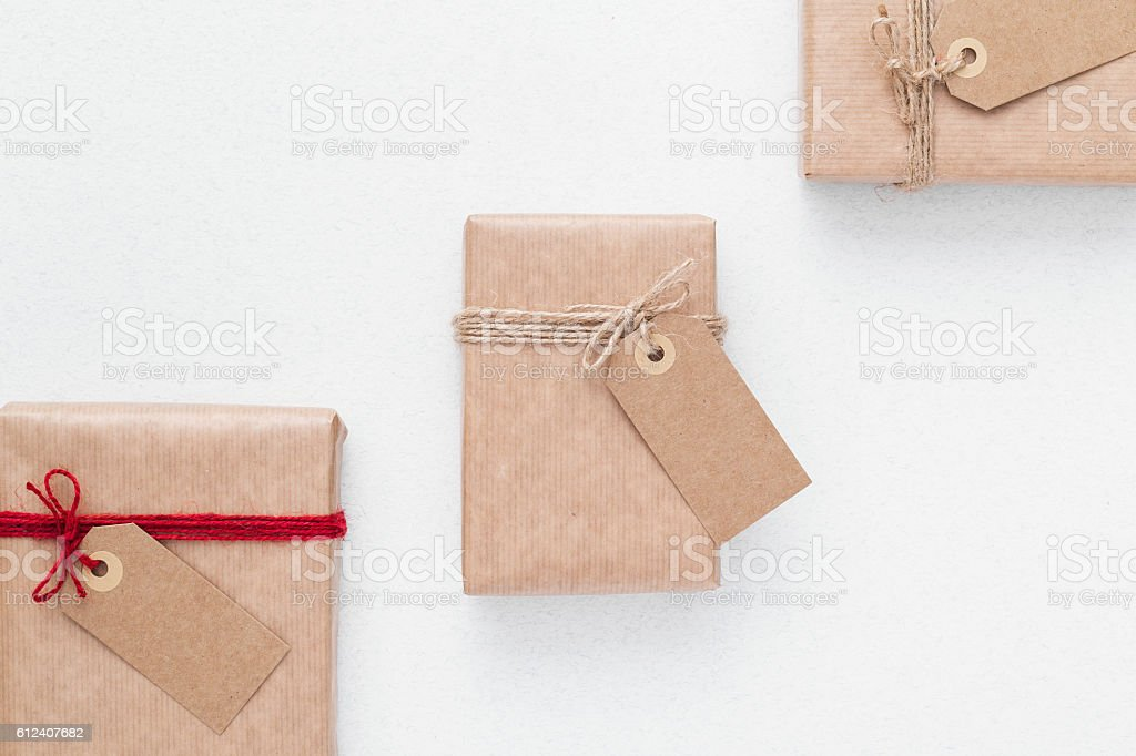 Packaging ideas. Wrapping inspiration. Packaging paper with labels. Packaging ideas. Wrapping inspiration. Packaging paper with labels. top view with copy space. Blackboard - Visual Aid Stock Photo