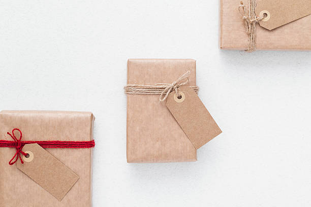 Packaging ideas. Wrapping inspiration. Packaging paper with labels. stock photo