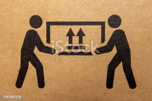 Packaging symbol to indicate heaviness and needs two people to lift