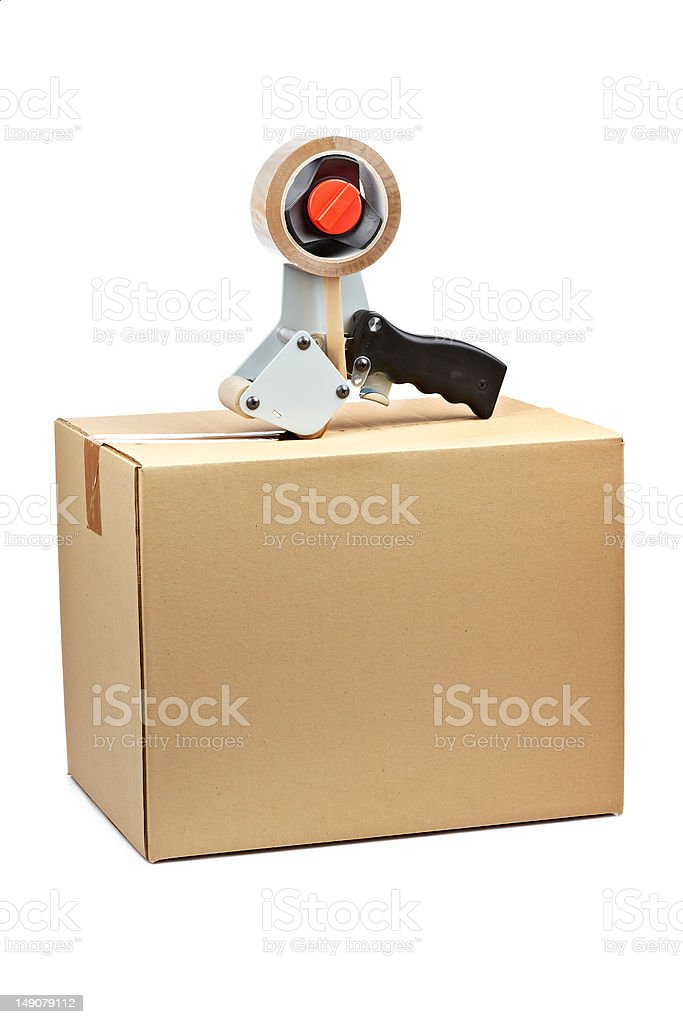 Packaging tape dispenser and shipping box stock photo