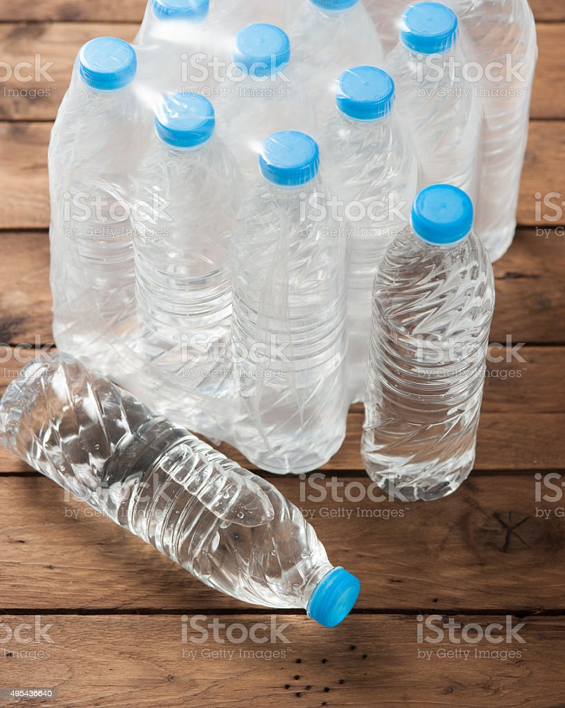 packed bottled water on wood