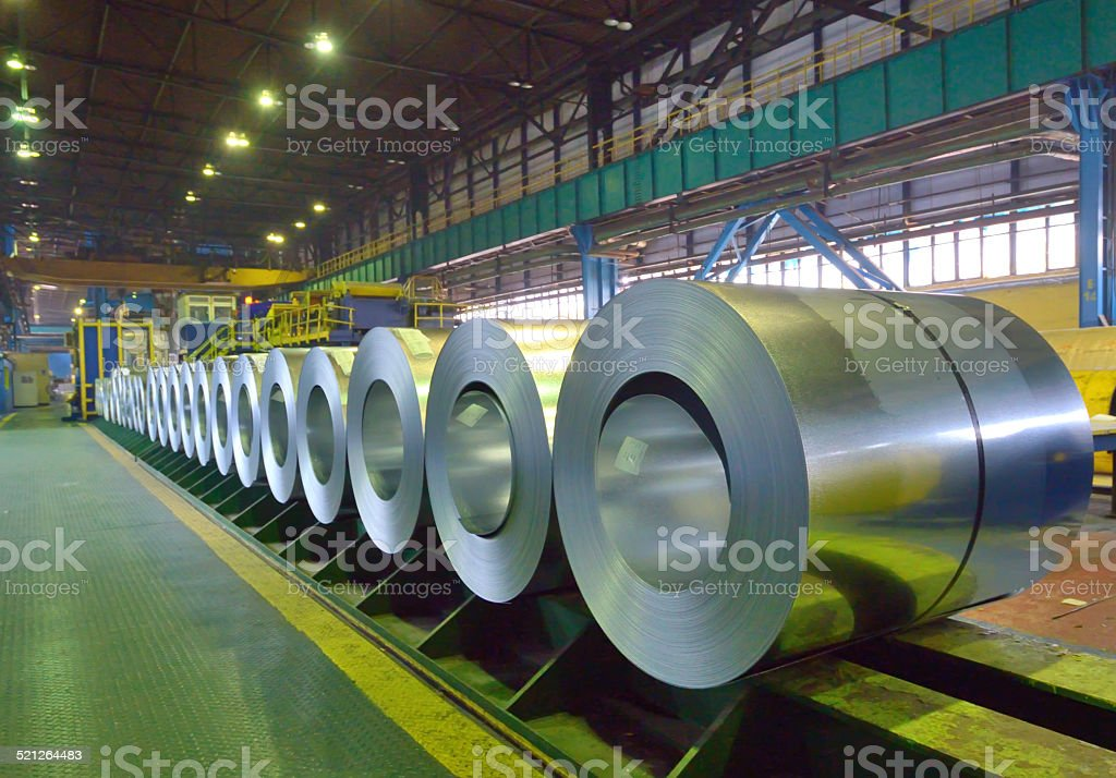 packed coils of steel sheet stock photo