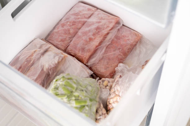 packed frozen vegetables at deep freeze macro view stock photo