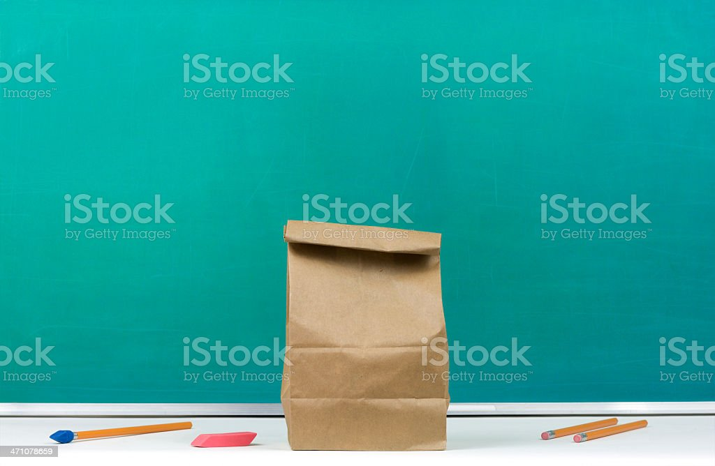 Packed Lunch in Front of Chalkboard royalty-free stock photo