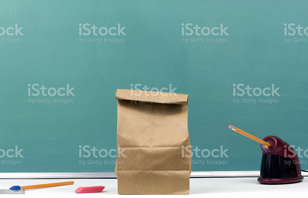Packed Lunch, School Supplies, and Chalkboard royalty-free stock photo