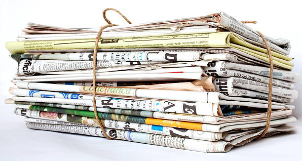 Packed newspaper Packed newspaper on a white background news stand stock pictures, royalty-free photos & images