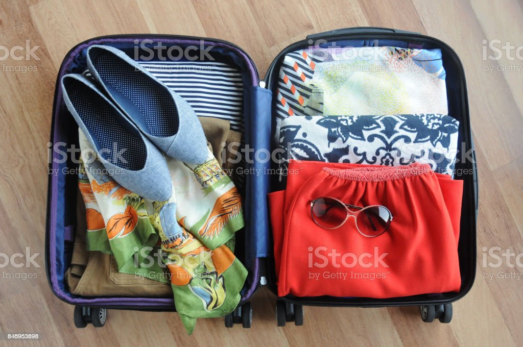 Packed Suitcase of Women's Clothing stock photo