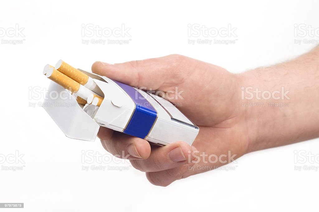 packet of cigarette in man's hand royalty-free stock photo