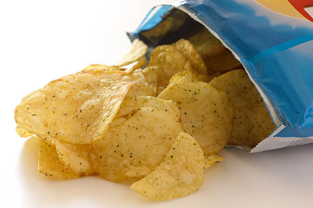 packet of crisps with cheese and spring onion flavour - crisp packet stock photos and pictures