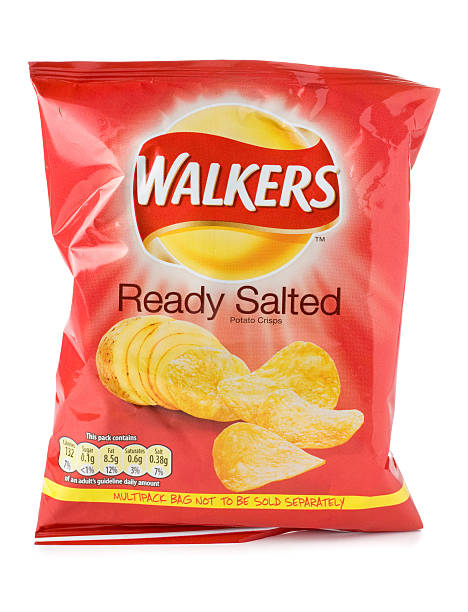 packet of walkers ready salted crisps on a white background - crisp packet stock photos and pictures