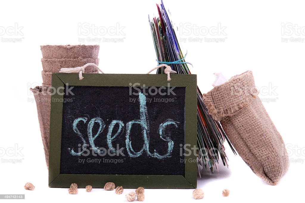packets of seeds, peat pots and a wooden plaque stock photo
