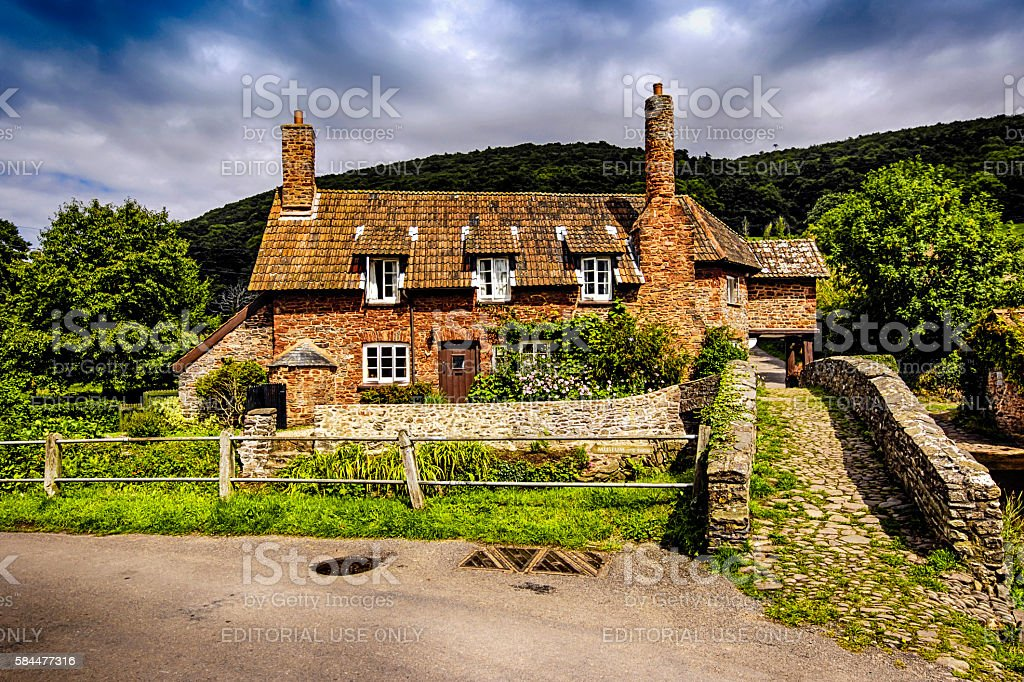Packhorse bridge and cottages at Allerford on Exmoor, UK stock photo