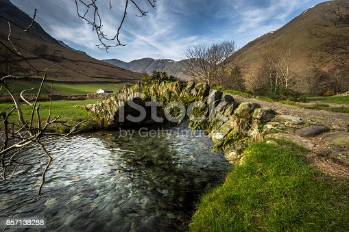 A view of an old packhorse bridge in Wasdale, in the Lake District, Cumbria, England.