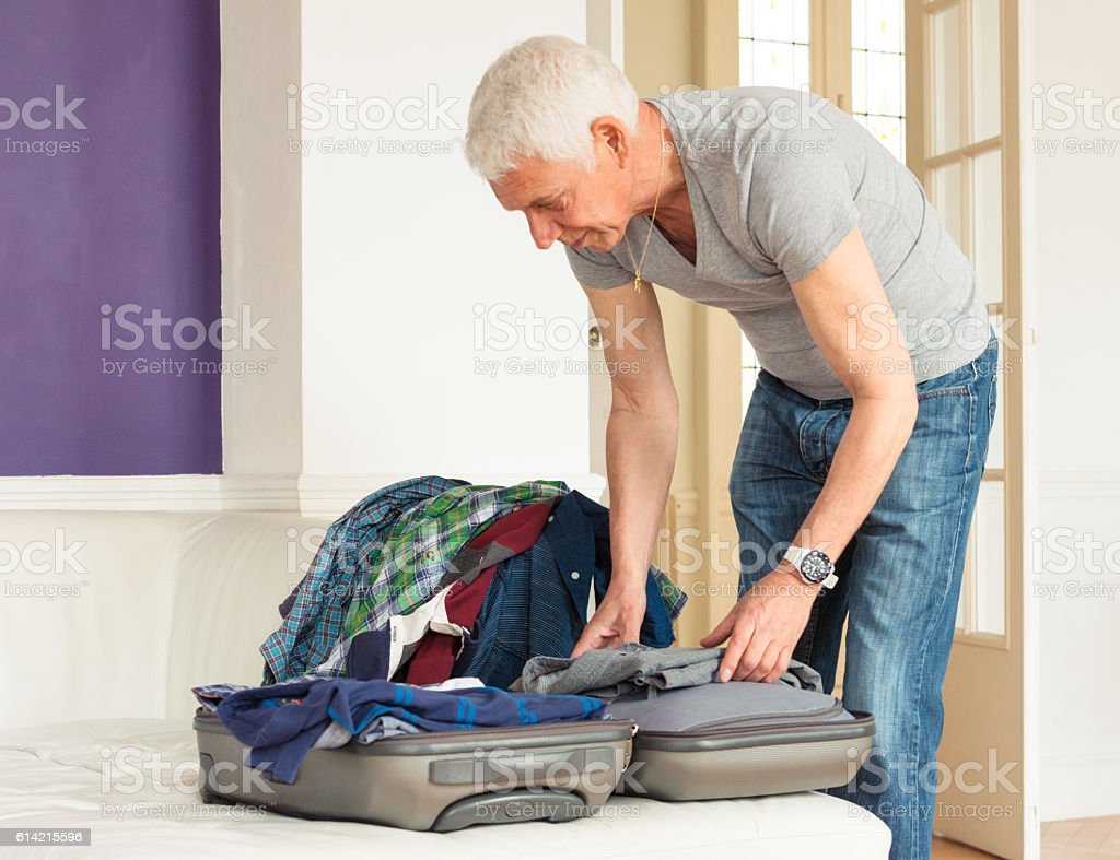 Packing a bag for vacation stock photo