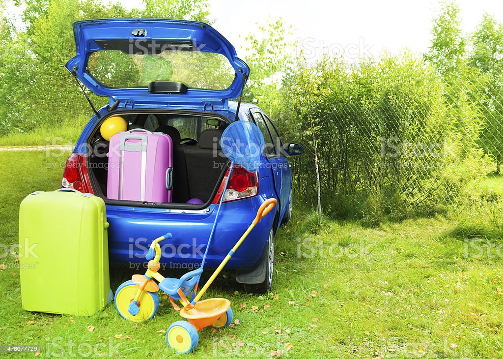 Packing a car for trip with kids stock photo