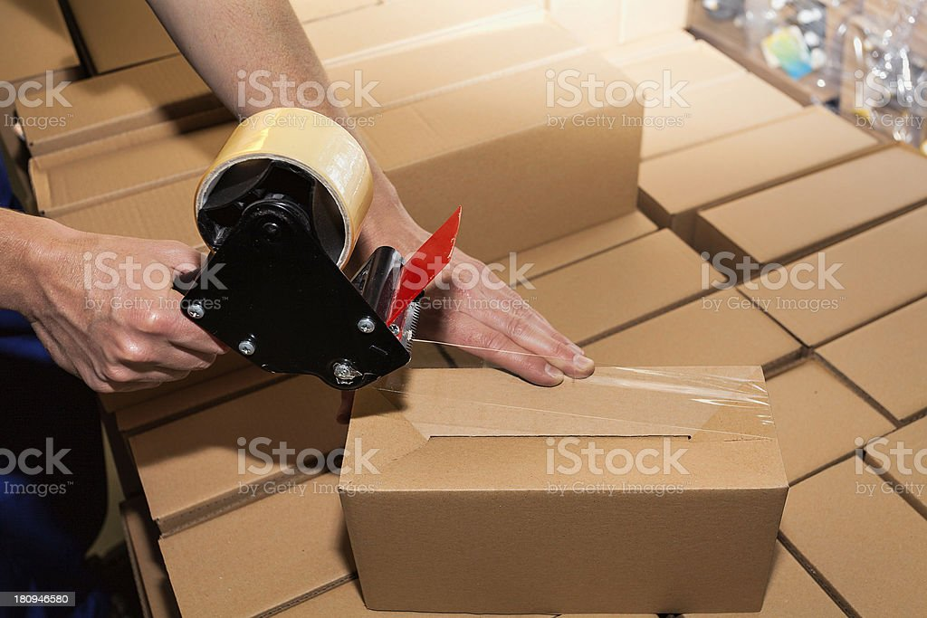 Packing a carton boxes stock photo