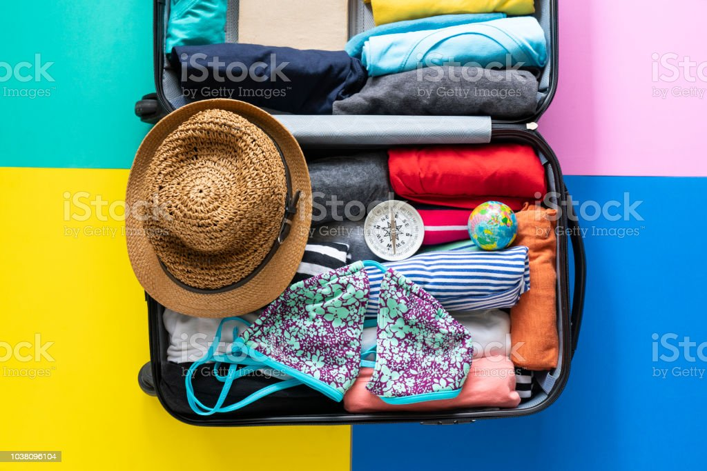 packing a luggage for a new journey and travel for a long weekend royalty-free stock photo
