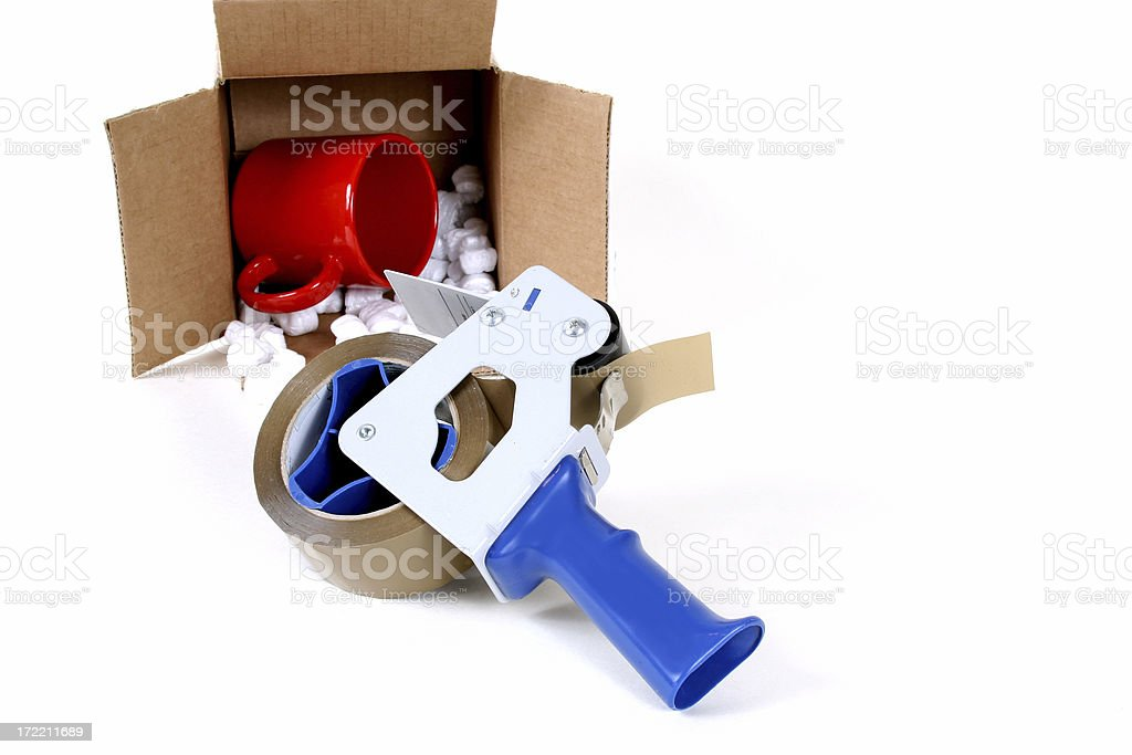 Packing and shipping supplies. Tape, cardboard box. royalty-free stock photo