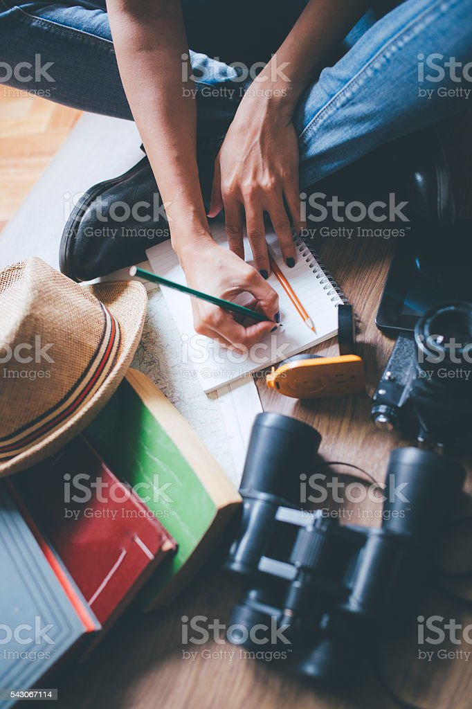 Packing Backpack for hiking and making travel plan stock photo