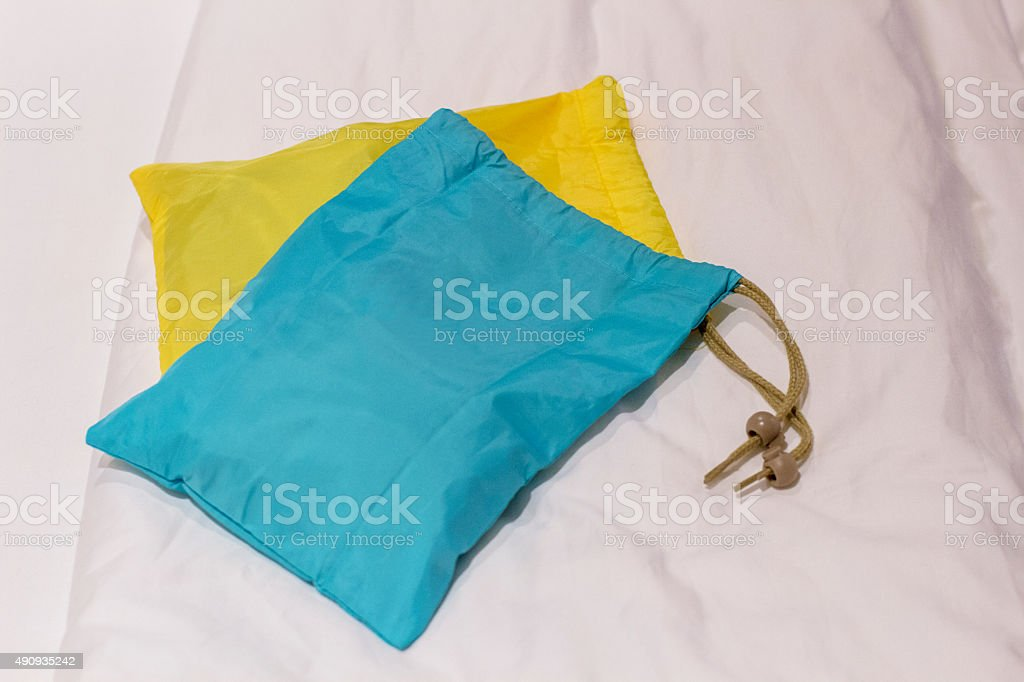 packing bags on bed stock photo