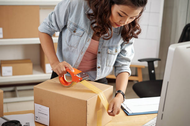 Packing customer's orders in box stock photo