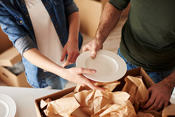 Packing dinnerware to the boxes stock photo
