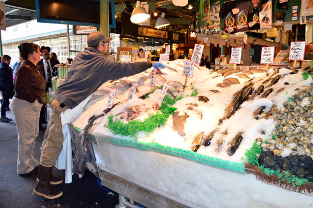 Packing fresh fish in Seattle stock photo