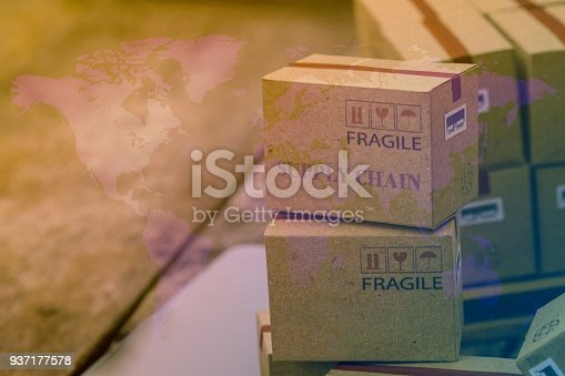 istock Packing light brown cardboard boxes with world map. An idea of transportation that can be done easily nowadays using an online internet at hand. Ready to ship worldwide. 937177578