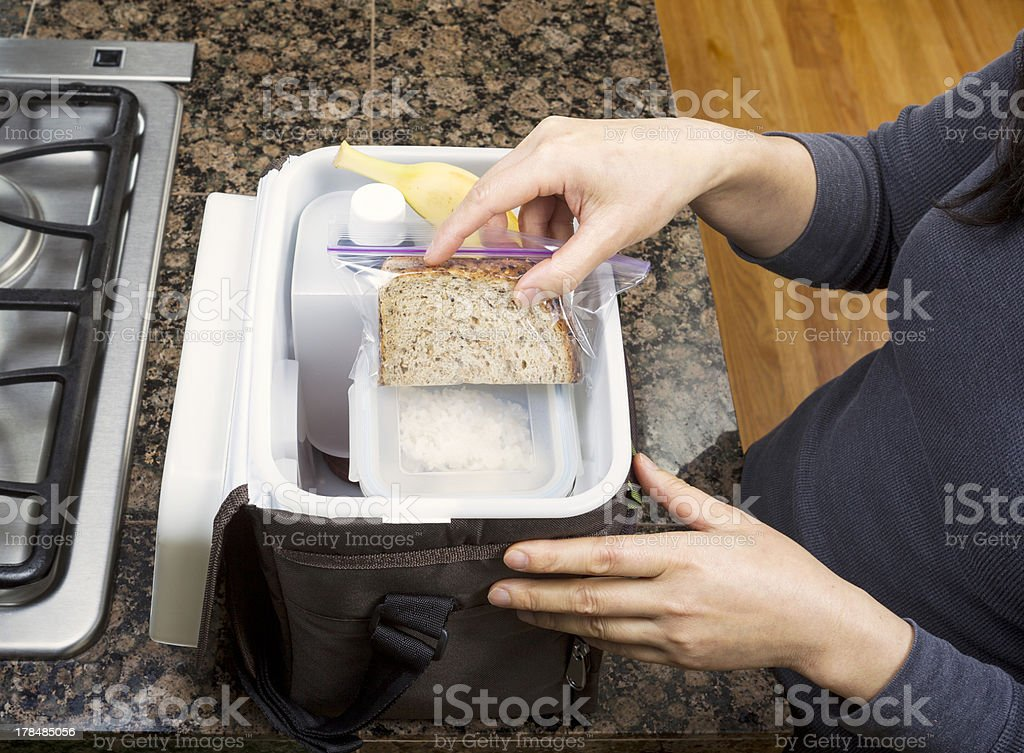 Packing Lunch into Carry Bag royalty-free stock photo