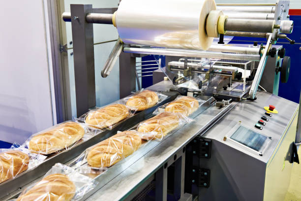 Packing machine for loaves bread stock photo