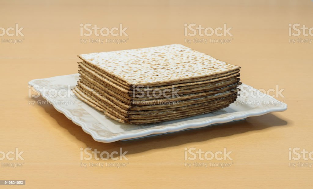 Packing  matzo for Pesach square shape lies on a plate on the table stock photo