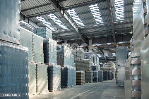 513948652 istock photo Packing of bottles in warehouse of glass factory 1144114617