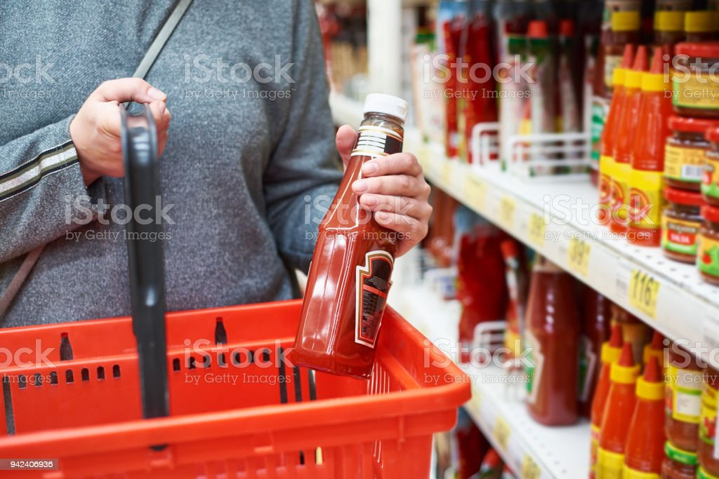 Packing of tomato ketchup in hands stock photo