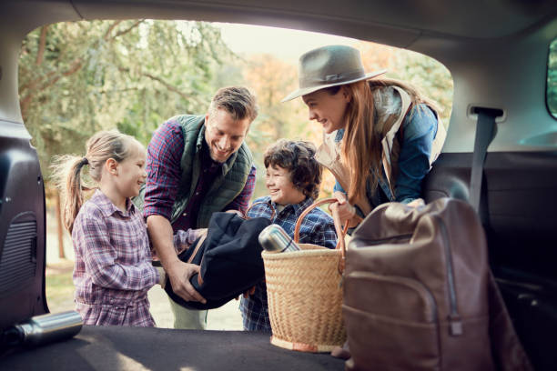 Packing Close up of a young family packing up for a road trip road trip stock pictures, royalty-free photos & images