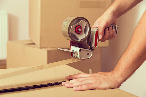 packing - adhesive tape stock photos and pictures