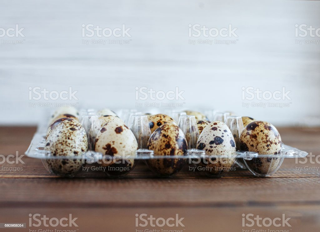 Packing quail eggs. The concept of healthy eating and vegetarianism royalty-free stock photo