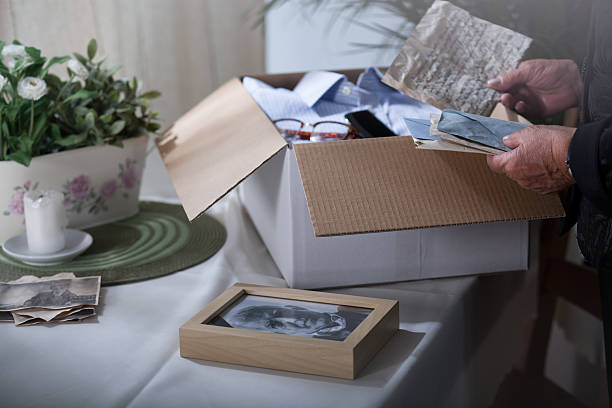 Packing remembrances after dead husband stock photo