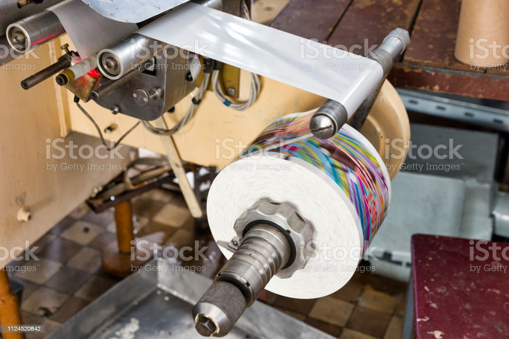 Packing tape is wound around a bobbin. Automatic production line of...