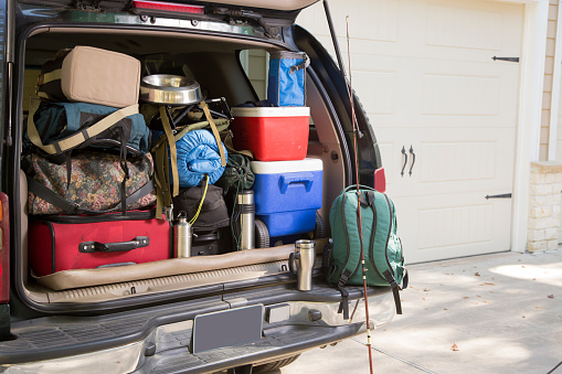 Vehicle fully packed for a hiking and camping trip. Dog bowl included. Fishing rod included.