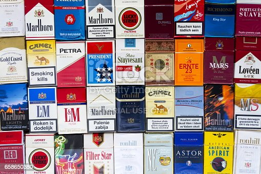 Prague, Czech republic - March 25, 2017: Many packs of different cigarettes photographed with top view flat lay composition on March 25, 2017 in Prague, Czech republic.