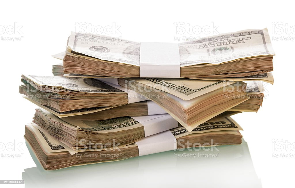Packs of dollars close-up isolated on white. foto stock royalty-free