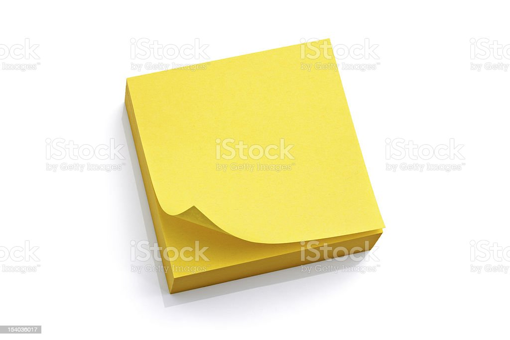 Pad of blank yellow sticky notes stock photo