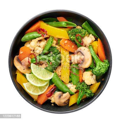 Pad Pak Ruam or Veg Thai Stir-Fried Vegetables in black bowl isolated on backdrop. Pad Pak is thailand cuisine vegetarian dish with mix of vegetables and sauces. Thai Food. Top view