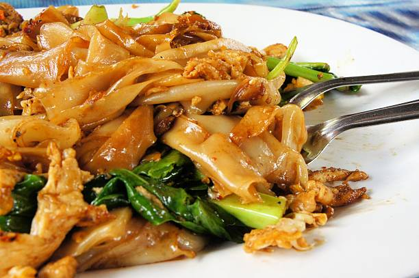 Pad See Ew, flat rice noodle stir fried with beef stock photo