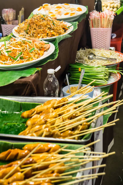 Pad Thai noodles and Sausage on banana leaf ready to eat on in street market Thailand ฺBangkok stock photo
