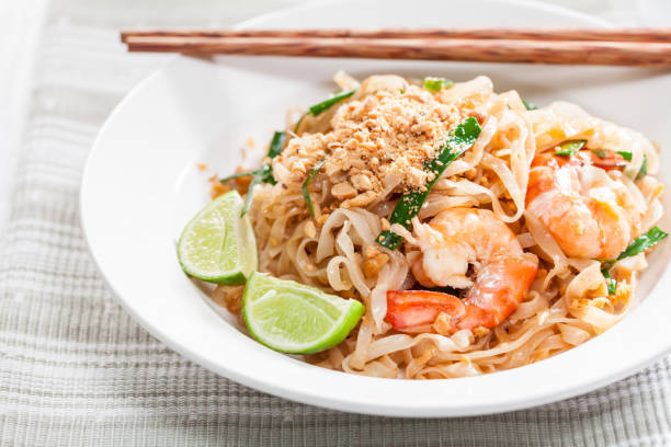 Pad Thai Stir Fried Asian Noodles With Shrimp, Egg, Tofu And Bean Sprouts stock photo