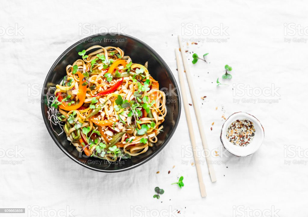 Pad Thai vegetarian vegetables udon noodles in a light background, top view. Vegetarian food in asian style stock photo