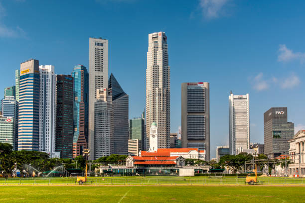 Padang field and financial district skyline, Singapore stock photo