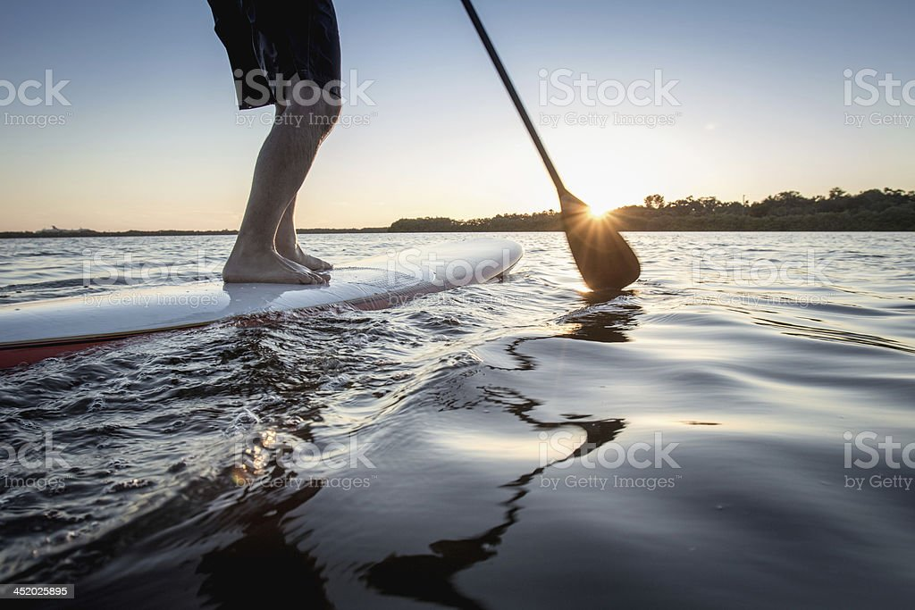 Paddle board surfer stock photo